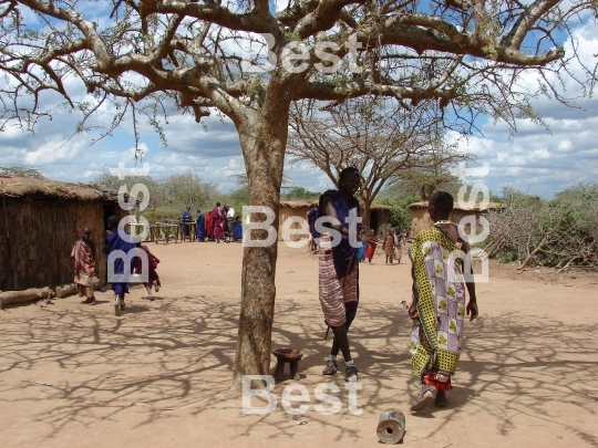 People in a traditional Masai village at the Nairobi-Mombasa road next to Tsavo National Park.